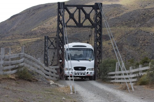 The minibus slowly squeezes across the bridge - Torres del Paine, Chile