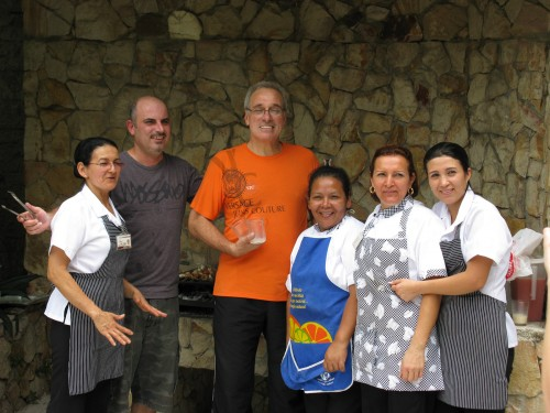 George (grey top), Enrique (orange top) and the kitchen staff